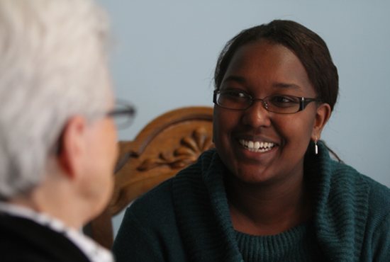 Monica Ngeno talks with Sister Katherine Mullin, vocations director for the Visitation Monastery of Minneapolis. Ngeno is working with the Eagan-based Labouré Society to raise money to pay off her student loan so that she will be debt free and able to join the Visitation Sisters. Dave Hrbacek/The Catholic Spirit
