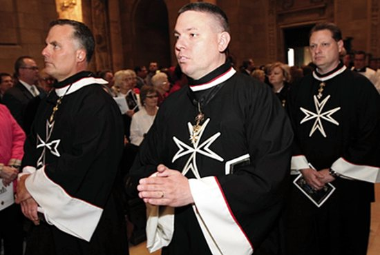 From left, Order of Malta members John Dick of All Saints in Minneapolis, Matt Heffron of St. Columba in St. Paul and Ivan Postumous of the Cathedral of St. Paul take part in the processional during the priest ordination Mass May 30 at the Cathedral. Dave Hrbacek/The Catholic Spirit
