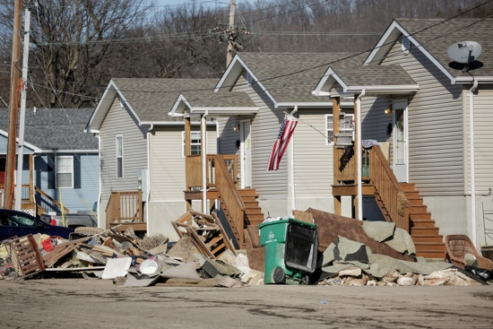 Debis is seen outside homes Jan. 5 in Pacific, Mo. The Mississippi River and other waterways in Missouri and Illinois flooded last week after 10-14 inches of rain fell over a wide swath of the two states in late December. (CNS photo/Lisa Johnston, St. Louis Review)