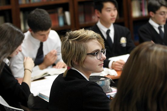 Sophomore Sophia Rybarczyk listens to Ahlquist during a theology class. Dave Hrbacek/The Catholic Spirit