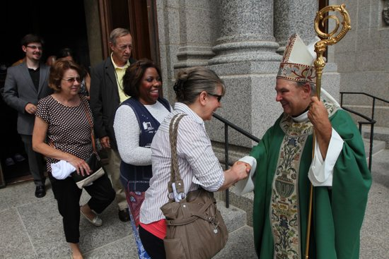 Archbishop-designate Bernard Hebda greets people outside the Cathedral of St. Paul July 12, 2015, at the end of his first Mass in the Archdiocese of St. Paul and Minneapolis. Dave Hrbacek/The Catholic Spirit