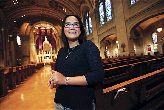 "Rafiann Olchefske, a catechumen at the Basilica of St. Mary in Minneapolis, likes the welcoming atmsophere there and looks forward to joining the Catholic Church at the Easter Vigil Mass at the Basilica March 26. ""My heart is with the Basilica,"" she said. Dave Hrbacek/The Catholic Spirit"