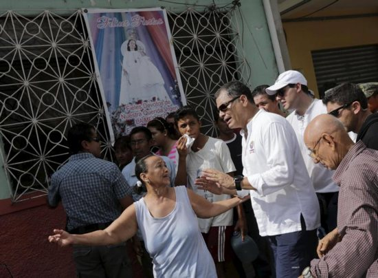 Ecuador's President Rafael Correa speaks with residents April 18 in Portoviejo after an earthquake off the country's Pacific coast. At least 272 people died, nearly 3,000 were injured and thousands were left homeless in the April 16 magnitude-7.8 earthquake. CNS photo/Henry Romero, Reuters