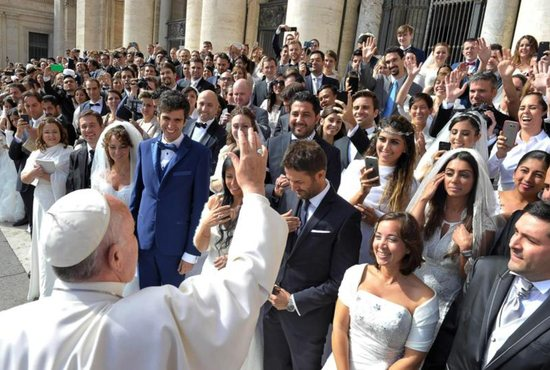 A newly married couple arrive in St. Peter's Square to attend Pope Francis' general audience at the Vatican in this Oct. 14, 2015, file photo. CNS photo/Paul Haring