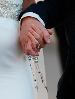 "A newly married couple hold rosaries in their hands as they leave Pope Francis' general audience in St. Peter's Square at the Vatican Feb. 24. Pope Francis' postsynodal apostolic exhortation on the family, ""Amoris Laetitia"" (""The Joy of Love""), was to be released April 8. The exhortation is the concluding document of the 2014 and 2015 synods of bishops on the family. CNS photo/Paul Haring"