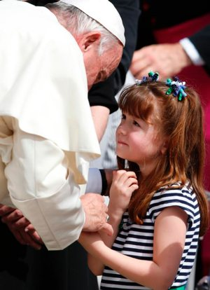 "Pope Francis greets Lizzy Myers of Mansfield, Ohio, during his general audience in St. Peter's Square at the Vatican April 6. Myers, who has a disease that is gradually rendering her blind and deaf, met the pope as part of her ""visual bucket list."" CNS photo/Paul Haring"