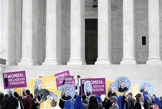 Women religious and others demonstrate against the Affordable Care Act's contraceptive mandate March 23 near the steps of the U.S. Supreme Court in Washington. CNS