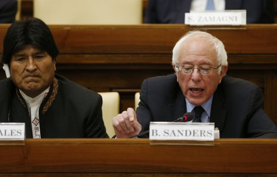 "Bolivia's President Evo Morales assists Sen. Bernie Sanders, D-Vt., a U.S. presidential candidate, upon the senator's arrival at a conference on Catholic social teaching at the Vatican April 15. The conference was dedicated to St. John Paul II's 1991 social encyclical ""Centesimus Annus"" and was sponsored by the Pontifical Academy of Social Sciences and the Institutute for Advanced Catholic Studies. CNS"