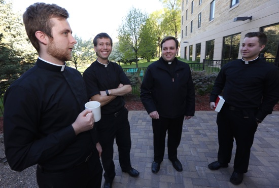 From left, seminarians Nicholas Froehle, Matthew Shireman, Paul Baker and Brandon Theisen talk between classes at the St. Paul Seminary. They are scheduled to be ordained transitional deacons May 14 by Archbishop-designate Bernard Hebda. Dave Hrbacek/The Catholic Spirit