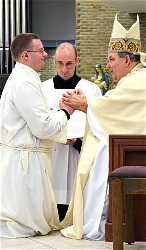 Bishop Bernard Hebda of Gaylord, Michigan, ordains Father Brian Medlin a transitional deacon in 2012 (above) and a priest in 2013. Courtesy the Diocese of Gaylord.