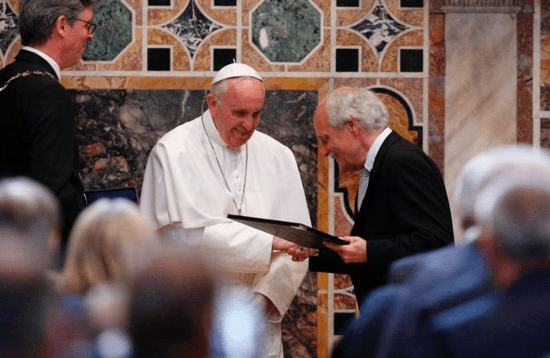 Pope Francis receives the Charlemagne Prize from Jurgen Linden, president of the Society for the Conferral of the Charlemagne Prize, during a ceremony in the Sala Regia at the Vatican May 6. At left is Marcel Philipp, mayor of Aachen, Germany, where the prize is normally presented. CNS photo/Paul Haring