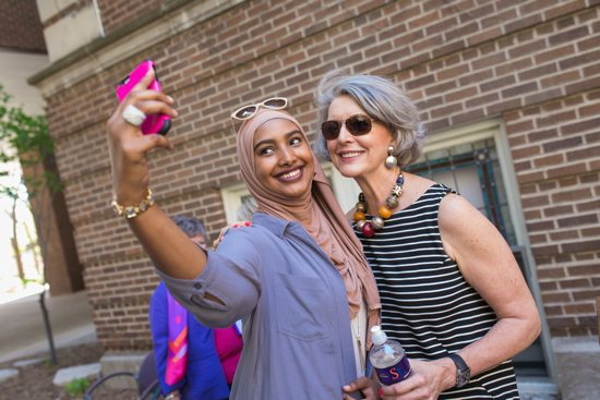 Public health/pre-physician assistant major Sundus Sabrie, class of 2017, gets a presidential selfie with Becky Roloff May 6. Courtesy St. Catherine University