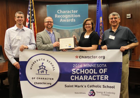 St. Mark's School Principal Zach Zechser, second from left, receives the 2016 Minnesota School of Character Award May 26 on behalf of the pre-kindergarten to eighth-grade school. Courtesy St. Mark's School