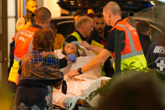 Paramedics rush a young woman to a waiting ambulance July 14 as they evacuate victims from the scene where a truck crashed into the crowd during the Bastille Day celebrations in Nice, France. More than 80 people were killed and the death toll was rising. CNS photo/Oliver Anrigo, EPA