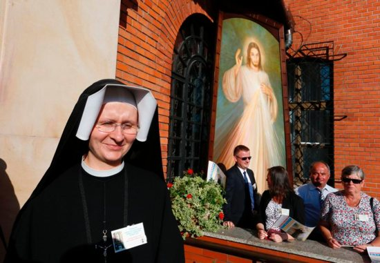 A nun is seen near an image of Jesus of Divine Mercy before Pope Francis' arrival to visit the Divine Mercy Shrine in Lagiewniki, a suburb of Krakow, Poland, July 30. CNS photo/Paul Haring)