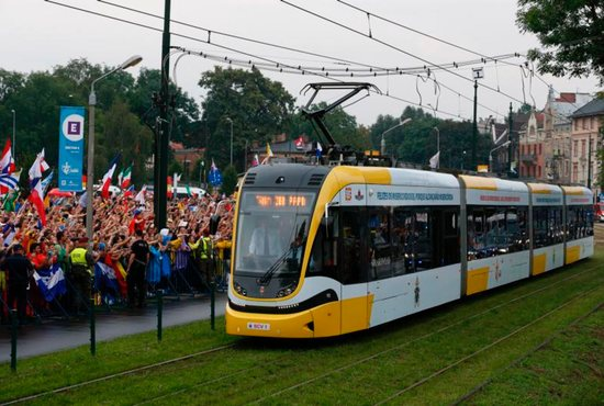 Pope Francis arrives on a tram for the World Youth Day welcoming ceremony in Blonia Park in Krakow, Poland, July 28. CNS photo/Paul Haring)