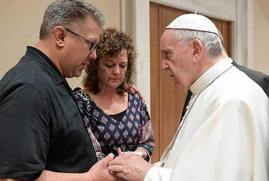 Pope Francis talks with Nick and Jodi Solomon, parents of U.S. student Beau Solomon, during a private meeting at the Vatican July 6. Solomon, a native of Spring Green, Wis., was found dead in the Tiber River in Rome July 4. A homeless man was detained as a suspect in the death. CNS