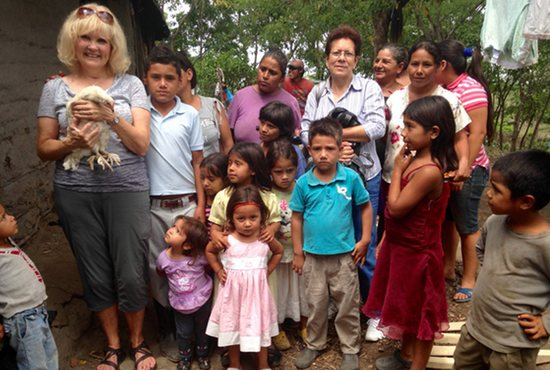 "Children from the Los Chaguites community in Jinotega, Nicaragua, give Sue Kellett a chicken in August 2015 as a token of their appreciation. ""I felt bad taking this chicken,"" Kellett said. ""I had to humbly accept it, so they could feel the pleasure of giving."" Courtesy Sue Kellett"