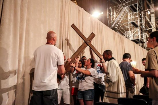 Young adults carry the cross during Stations of the Cross at the Basilica of the National Shrine of the Immaculate Conception in Washington July 30 as a way of being in unison with World Youth Day pilgrims in Krakow, Poland. CNS photo/Brian Searby, Catholic Standard