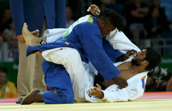 Refugee Olympic Team's Popole Misenga, left, and Avtar Singh of India compete in judo during the Summer Olympics in Rio de Janeiro Aug. 10. CNS photo/Toru Hanai, Reuters
