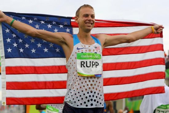 Marathon runner Galen Rupp poses with an American flag after finishing third in the 2016 Olympics in Rio de Janeiro Aug. 21. Rupp, a graduate of Central Catholic High School in Portland, Ore., became the first American-born athlete to medal in the marathon in 40 years. CNS photo/Lucy Nicholson, Reuters