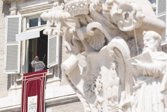 Pope Francis leads the Angelus in St. Peter's Square at the Vatican Aug. 21. CNS photo/Giorgio Onorati, EPA