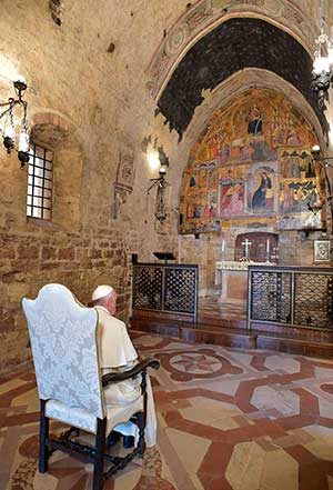 Pope Francis prays in the Portiuncola, the chapel inside the Basilica of St. Mary of the Angels, in Assisi, Italy, Aug. 4. CNS/L'Osservatore Romano