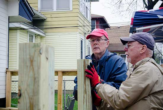 From left, Tom Schermerhorn and Paul Thornton, members of the Honeywell Retired Volunteer Program, work with Rebuilding Together's Ramp Program to build a wheelchair ramp for a local homeowner. Courtesy Angela Dimler/Catholic Community Foundation