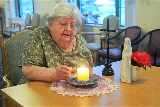 Agnes Imdieke of Albany, Minn., pictured Sept. 6, has been lighting a candle for Jacob Wetterling every morning since he disappeared in October 1989. A Minnesota man confessed to kidnapping and killing the boy Sept. 6. CNS photo/Dianne Towalski, The Visitor