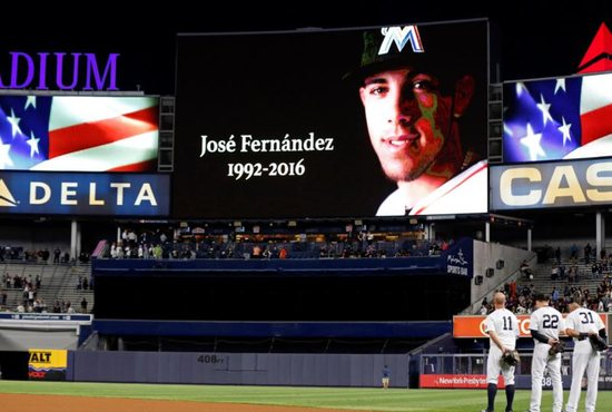 A moment of silence is observed for Miami Marlins Jose Fernandez prior to the New York Yankees taking on the Boston Red Sox Sept. 27 at Yankee Stadium. The 24-year-old pitcher, who defected from Cuba at 15 and went on to become one of baseball's brightest stars, was killed Sept. 25 in a boating accident in Miami Beach, along with two other men. CNS photo/Adam Hunger, USA TODAY Sports via Reuters