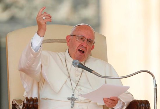 Pope Francis speaks during his general audience in St. Peter's Square at the Vatican Sept. 14. CNS photo/Paul Haring)