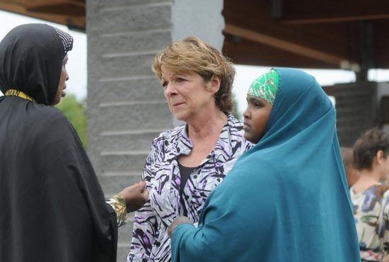 Kathy Langer, director of social concerns for Catholic Charities of the Diocese of St. Cloud, Minn., center, talks with Maryan Ahmed and Fatumo Ukash following a Sept. 18 news conference organized by the local Somali-American community in St. Cloud after a knife-wielding man injured nine people the previous day at a shopping mall. Bishop Donald J. Kettler of St. Cloud called for prayers for those impacted by the violence. CNS photo/Dianne Towalski, The Visitor