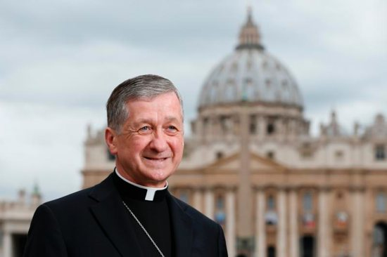Cardinal-designate Blase J. Cupich of Chicago is pictured with St. Peter's Basilica in the background in Rome Oct. 13. The cardinal-designate is one of 17 new cardinals to be created by Pope Francis at a Vatican consistory Nov. 19. CNS photo/Paul Haring
