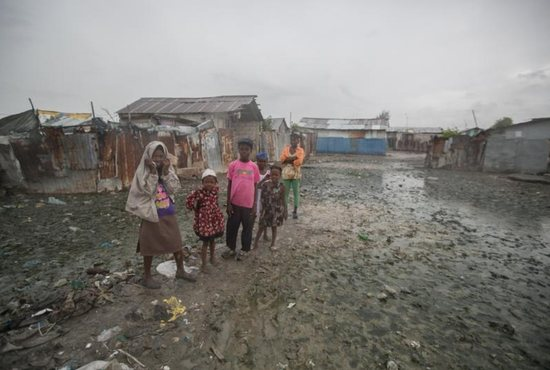 Hatian children stand in mud outside their homes Oct. 3 in Cite Soleil, a slum in Port-au-Prince, hours before Hurricane Matthew hit the island nation. Hurricane Matthew roared into the southwestern coast of Haiti Oct. 4, threatening a largely rural corner of the impoverished country with devastating storm conditions as it headed north toward Cuba and the eastern coast of Florida. CNS photo/Bahare Khodabande, Reuters