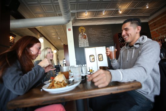 From left, Sarah Robinson, Andria Kroona and Alex Sanchez eat lunch at Augustine's Bar and Bakery in St. Paul Nov. 15. Dave Hrbacek/The Catholic Spirit