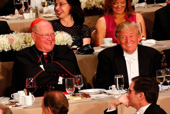 New York Cardinal Timothy M. Dolan and Donald Trump, then the Republicans' nominee for U.S. president, smile during the 71st annual Alfred E. Smith Memorial Foundation Dinner at the Waldorf Astoria hotel in New York City Oct. 20. Cardinal Dolan says he hopes promises made by Trump, now president-elect, on life issues will become his administration's policies and that the pro-life community will hold him accountable to those promises. CNS photo/Gregory A. Shemitz