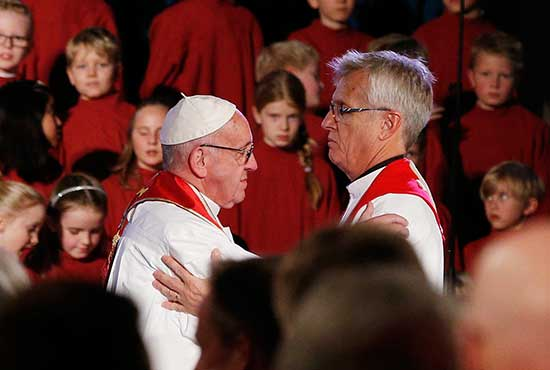 Pope Francis embraces the Rev. Martin Junge, general secretary of the Lutheran World Federation, during an ecumenical prayer service at the Lutheran cathedral in Lund, Sweden, Oct. 31. CNS/Paul Haring