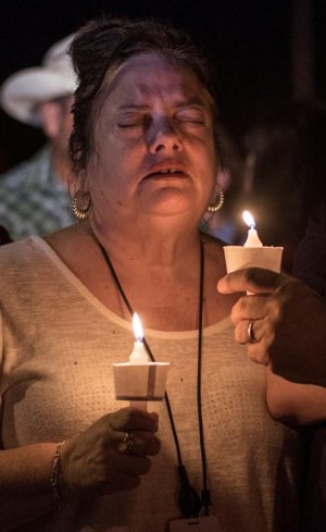Candlelight vigil after mass shooting in Texas