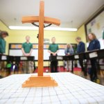 Traveling crucifixes help students think about, pray for vocations