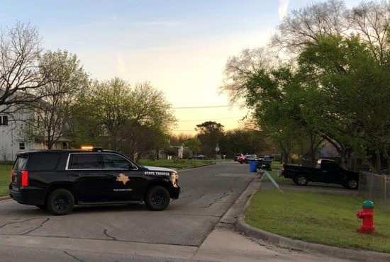 A Texas state trooper blocks a street March 21 in a neighborhood of Pfluggerville, Texas, an Austin suburb, where bombing suspect Mark A. Conditt, 24, may have lived.