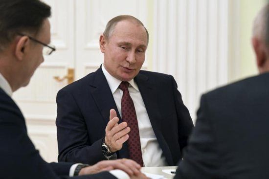 Russian President Vladimir Putin meets with co-chairs of his campaign