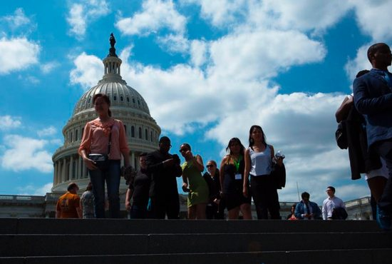 People walk near the U.S. Capitol in Washington to preserve the Deferred Action for Childhood Arrivals program, or DACA