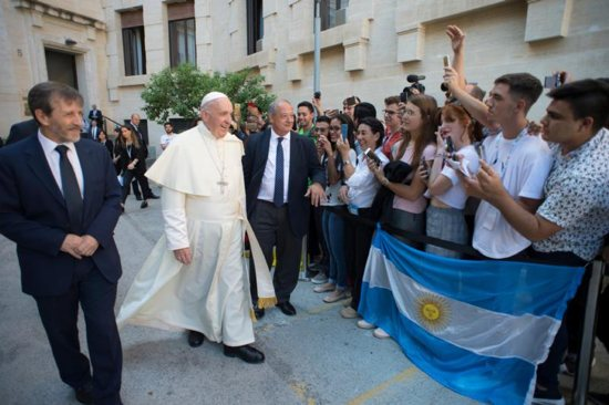 Pope Francis passes youths holding cell phones taking selfies