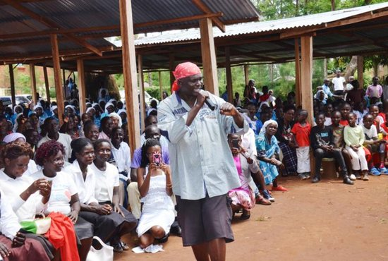 Father Paul Ogalo performs rap songs about drug abuse, food insecurity, and the environment at St. Monica Church in Rapogi, Kenya