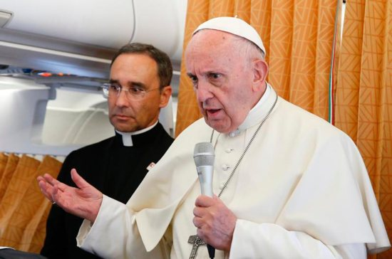 Pope Francis answers questions from journalists aboard his flight from Geneva to Rome