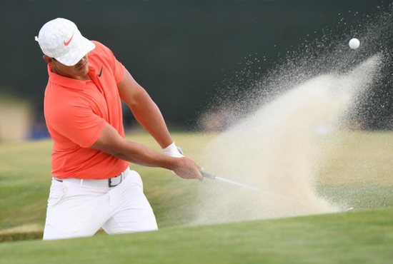 Brooks Koepka hits from a bunker during the third round of the U.S. Open golf tournament at Shinnecock Hills