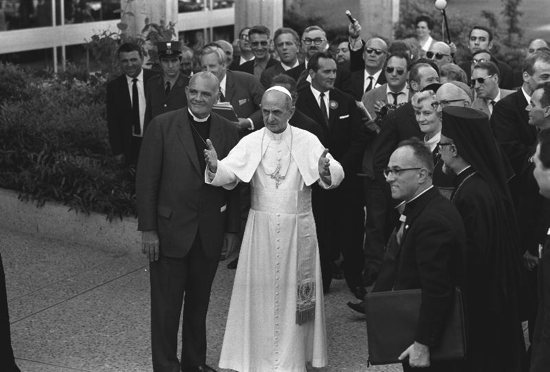 Pope Paul VI stands next to Eugene Blake, general secretary of the World Council of Churches, as he arrives at the headquarters of the WCC in Geneva June 10, 1969