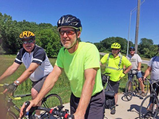 Bishop Thomas Zinkula of Davenport, Iowa, foreground, leads the Bishop's Bike Ride in Iowa City July 6.
