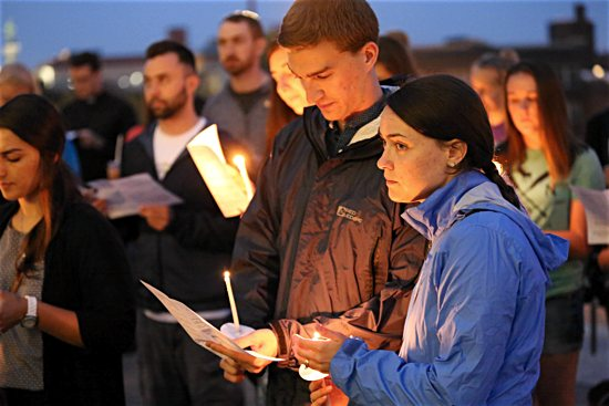 Brett and Bridget Hutchinson of St. Thomas More in St. Paul pray with other young adults gathered on the steps of the Cathedral of St. Paul