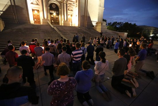 Young adults about 120 Catholics gathered at the bottom of the steps of the Cathedral of St. Paul to pray for survivors of clergy sexual abuse and for a cleansing of the Church